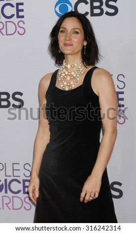 LOS ANGELES - OCT 4:  Carrie-Anne Moss arrives at the 2013 Peoples Choice Awards  on January 9, 2013 in Los Angeles, CA              - stock photo