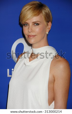 LOS ANGELES - OCT 4:  Charlize Theron arrives at the Variety 5th Annual Power of Women Event   on October 4, 2013 in Beverly Hills, CA                 - stock photo