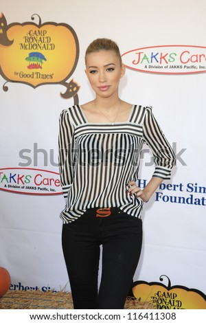 LOS ANGELES - OCT 21: Christian Serratos at the Camp Ronald McDonald for Good Times 20th Annual Halloween Carnival at the Universal Studios Backlot on October 21, 2012 in Los Angeles, California - stock photo