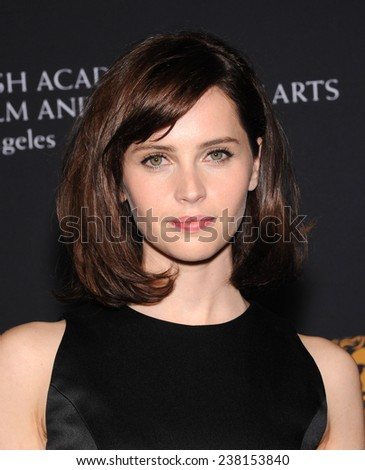 LOS ANGELES - OCT 30:  Felicity Jones arrives to the BAFTA Jaguar Brittannia Awards 2014 on October 30, 2014 in Beverly Hills, CA                 - stock photo
