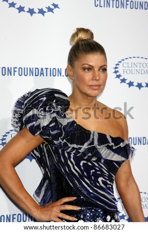 "LOS ANGELES - OCT 14:  Fergie aka Stacey Ferguson arriving at the Clinton Foundation ""Decade of Difference"" Gala at the Hollywood Palladium on October 14, 2011 in Los Angelees, CA"