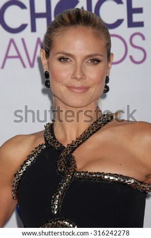 LOS ANGELES - OCT 4:  Heidi Klum arrives at the 2013 Peoples Choice Awards  on January 9, 2013 in Los Angeles, CA              - stock photo