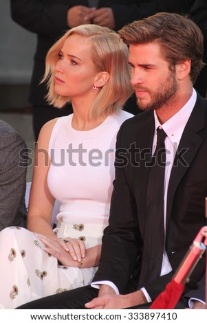 LOS ANGELES - OCT 31:  Jennifer Lawrence, Liam Hemsworth at the Hunger Games Handprint and Footprint Ceremony at the TCL Chinese Theater on October 31, 2015 in Los Angeles, CA - stock photo