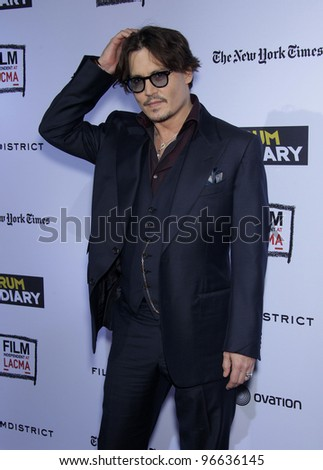 """LOS ANGELES - OCT 13:  Johnny Depp arrives to the """"Rum Diary"""" World Premiere  on October 13, 2011 in Los Angeles, CA - stock photo"""
