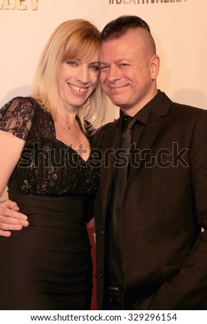 """LOS ANGELES- OCT 17: Juliette and Sean Beavan arrive at the """"Death Valley"""" film premiere Oct. 17, 2015 at Raleigh Studios in Los Angeles, CA. - stock photo"""