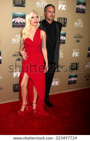 """LOS ANGELES - OCT 3:  Lady Gaga, Taylor Kinney at the """"American Horror Story: Hotel"""" Premiere Screening at the Regal 14 Theaters on October 3, 2015 in Los Angeles, CA - stock photo"""