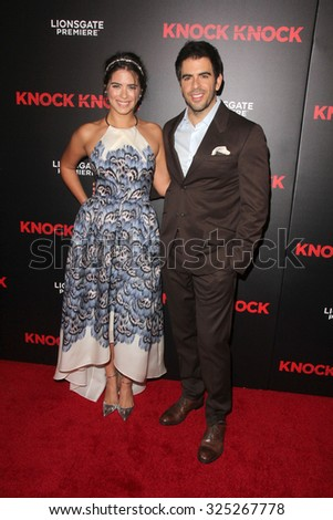 """LOS ANGELES - OCT 7:  Lorenza Izzo, Eli Roth at the """"Knock Knock"""" Los Angeles Premiere at the TCL Chinese 6 Theaters on October 7, 2015 in Los Angeles, CA - stock photo"""