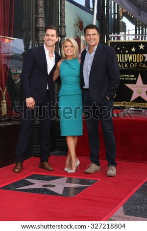 LOS ANGELES - OCT 12:  Matt Bomer, Kelly Ripa, Ted McGinley at the Kelly Ripa Hollywood Walk of Fame Ceremony at the Hollywood Walk of Fame on October 12, 2015 in Los Angeles, CA - stock photo