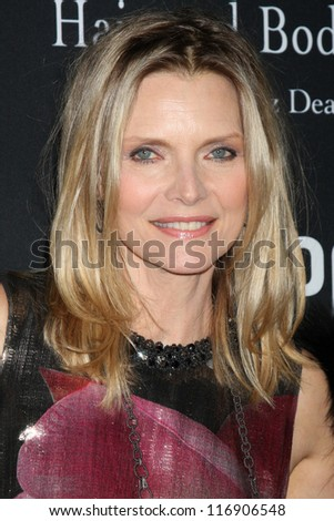 "LOS ANGELES - OCT 26:  Michelle Pfeiffer arrives at ""The Pink Party '12"" at Hanger 8 on October 26, 2012 in Santa Monica, CA - stock photo"