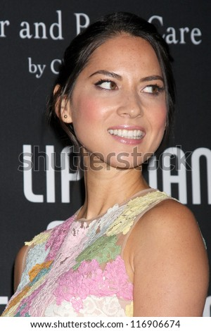 "LOS ANGELES - OCT 26:  Olivia Munn arrives at ""The Pink Party '12"" at Hanger 8 on October 26, 2012 in Santa Monica, CA - stock photo"