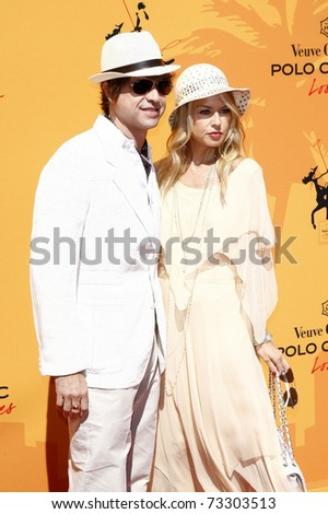LOS ANGELES - OCT 10:  Rachel Zoe and husband Rodger Berman arriving at the Veuve Cliquot Polo Classic Los Angeles at Will Rogers Park, Los Angeles, California on October 10,  2010. - stock photo