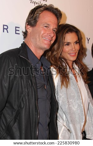 "LOS ANGELES - OCT 23:  Rande Gerber, Cindy Crawford at the De Re Gallery & Casamigos Host The Opening Brian Bowen Smith's ""Wildlife"" Show at De Re Gallery on October 23, 2014 in West Hollywood, CA"
