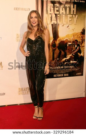 """LOS ANGELES- OCT 17: Reanin Johannink arrives at the """"Death Valley"""" film premiere Oct. 17, 2015 at Raleigh Studios in Los Angeles, CA. - stock photo"""
