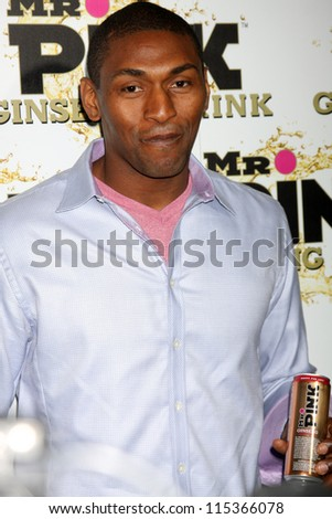 "LOS ANGELES - OCT 11:  Ron Artest aka Metta World Peace arrives at the ""Mr. Pink"" Energy Drink Launch at Beverly Wilshire Hotel on October 11, 2012 in Beverly Hills, CA - stock photo"