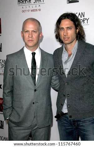 """LOS ANGELES - OCT 13:  Ryan Murphy, Brad Flachuk arrives at the """"American Horror Story: Asylum"""" Premiere Screening at Paramount Theater on October 13, 2012 in Los Angeles, CA - stock photo"""