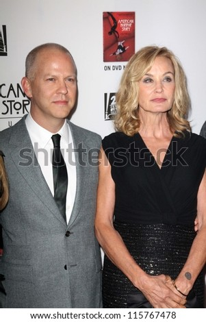 """LOS ANGELES - OCT 13:  Ryan Murphy, Jessica Lange arrives at the """"American Horror Story: Asylum"""" Premiere Screening at Paramount Theater on October 13, 2012 in Los Angeles, CA - stock photo"""