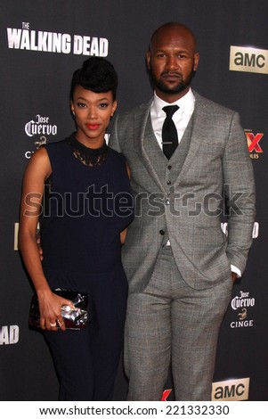 """LOS ANGELES - OCT 2:  Sonequa Martin-Green, Kenric Green at the """"The Walking Dead"""" Season 5 Premiere at Universal City Walk on October 2, 2014 in Los Angeles, CA - stock photo"""