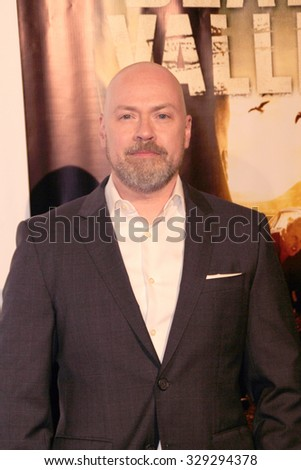 """LOS ANGELES- OCT 17: Steven DeKnight arrives at the """"Death Valley"""" film premiere Oct. 17, 2015 at Raleigh Studios in Los Angeles, CA. - stock photo"""