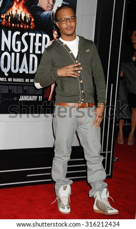 LOS ANGELES - OCT 4:  T.I. arrives at the Gangster Squad World Premiere  on January 7, 2013 in Hollywood, CA              - stock photo