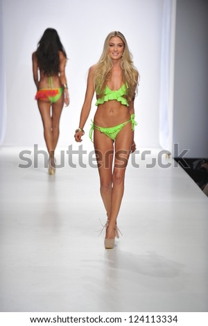 LOS ANGELES - OCTOBER 19: Model walks runway at the Kate Swim Fashion Show for SS 2013 at Sunset Gower Studios during Los Angeles Fashion Weekend on October 19, 2012 in Los Ageles, CA - stock photo