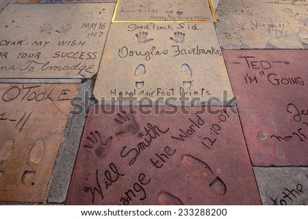LOS ANGELES - OCTOBER 25: Super star's handprints in Hollywood Boulevard on October 25, 2014 in Hollywood. There are nearly 200 celebrity handprints in the concrete of Chinese Theatre's forecourt. - stock photo
