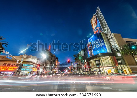 LOS ANGELES - OCTOBER 15, 2015: View of Hollywood Boulevard by night. In 1958, the Hollywood Walk of Fame was created on this street as a tribute to artists working in the entertainment industry. - stock photo