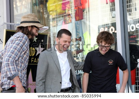 LOS ANGELES - SEP 19:  Ashton Kutcher,  Jon Cryer, Angus T. Jones at the Jon Cryer Hollywood Walk of Fame Star Ceremony at Hollywood Walk of Fame on September 19, 2011 in Los Angeles, CA - stock photo