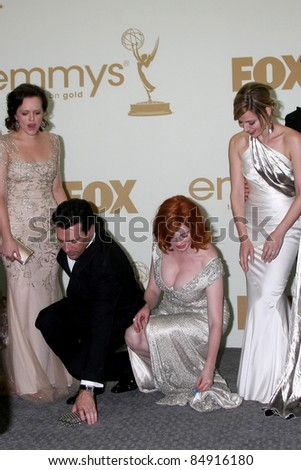 LOS ANGELES - SEP 18:  Elisabeth Moss, Jon Hamm, Christina Hendricks in the Press Room at the 63rd Primetime Emmy Awards at Nokia Theater on September 18, 2011 in Los Angeles, CA - stock photo
