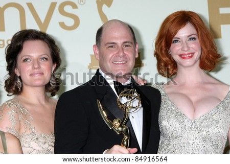LOS ANGELES - SEP 18:  Elisabeth Moss, Matthew WEiner, Cara Buono in the Press Room at the 63rd Primetime Emmy Awards at Nokia Theater on September 18, 2011 in Los Angeles, CA - stock photo