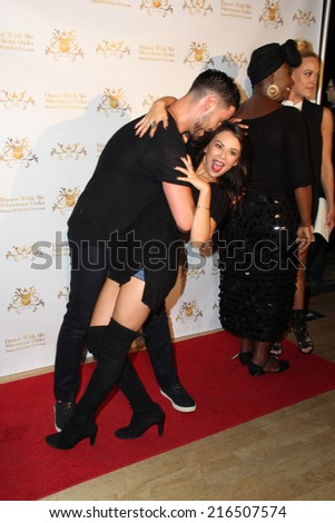 LOS ANGELES - SEP 10:  Janel Parrish, Valentin Chmerkovskiy at the Dance With Me USA Grand Opening at Dance With Me Studio on September 10, 2014 in Sherman Oaks, CA - stock photo