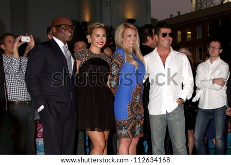 LOS ANGELES - SEP 11:  LA Reid, Demi Lovato, Britney Spears, Simon Cowell at the FOX  X-Factor Judges Handprint Ceremony at Graumans Chinese Theater on September 11, 2012 in Los Angeles, CA - stock photo