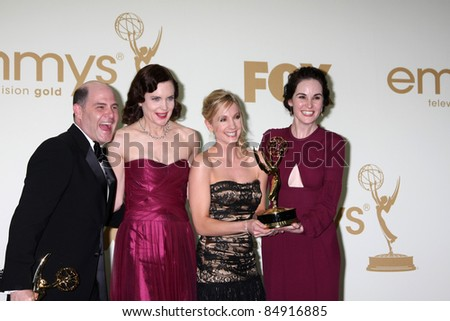 LOS ANGELES - SEP 18: Matthew Weiner, Elizabeth McGovern, Joanne Froggatt, Michelle Dockery in the Press Room at the 63rd Primetime Emmy Awards at Nokia Theater on September 18, 2011 in Los Angeles,CA - stock photo