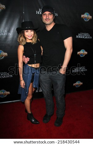 LOS ANGELES - SEP 18:  Vanessa Hudgens, Robert Rodriguez at the Universal Studio's Halloween Horror Nights 2014 Eyegore Award at Universal Studios on September 18, 2014 in Los Angeles, CA - stock photo