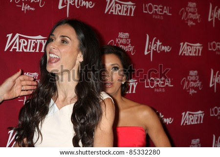 LOS ANGELES - SEPT 23:  Demi Moore, Eva Longoria arriving at the Variety's Power of Women Luncheon at Beverly Wilshire Hotel on September 23, 2011 in Beverly Hills, CA - stock photo