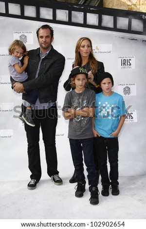 LOS ANGELES - SEPT 25: Kim Raver, family at the IRIS, A Journey Through the World of Cinema by Cirque du Soleil premiere at the Kodak Theater on September 25, 2011  in Los Angeles, California - stock photo