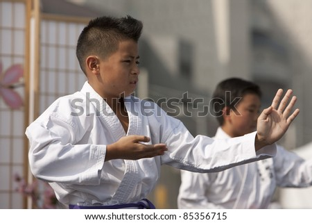 LOS ANGELES - SEPT 25:  Ryan, 11, and Daniel, 11, perform a traditional Kata at Little Tokyo's Cherry Blossom Festival on September 25, 2011 in Los Angeles, CA. - stock photo