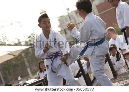 LOS ANGELES - SEPT 25:  Ryan, 11, and Daniel 11, spar at Little Tokyo's Cherry Blossom Festival on September 25, 2011 in Los Angeles, CA. - stock photo