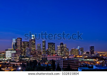 Los Angeles Skyline At Night Against a Rare Clear Blue Sky - stock photo