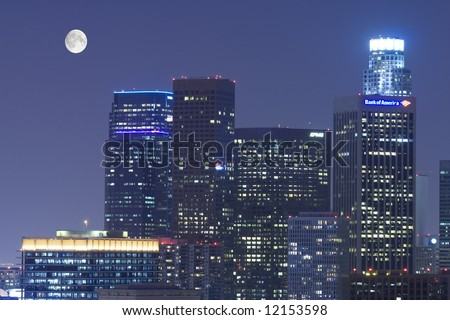 Los Angeles skyline at night under the moon
