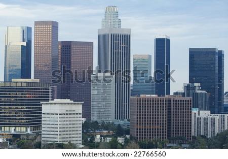 Los Angeles skyline in daylight against blue sky. - stock photo