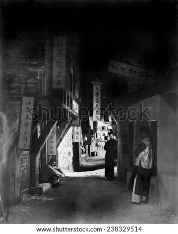 Los Angeles, three people in an alley, original title: 'Neighbors of the Alley', Chinatown, California, 1922. - stock photo