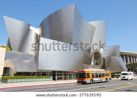 LOS ANGELES, USA - APRIL 5, 2014: City bus drives by Walt Disney Concert Hall in Los Angeles. The famous landmark was designed by Frank Gehry. - stock photo