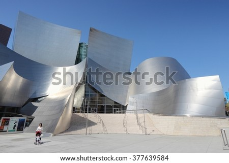 LOS ANGELES, USA - APRIL 5, 2014: Person visits Walt Disney Concert Hall in Los Angeles. The famous landmark was designed by Frank Gehry. - stock photo