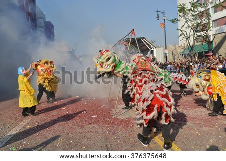 Los Angeles, USA - February 13, 2016: Chinese New Year Firecrackers during the 117th Golden Dragon Parade, celebrating Chinese New Year and the Year of the Monkey. - stock photo
