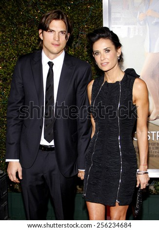 """LOS ANGELES, USA - JANUARY 11: Ashton Kutcher and Demi Moore at the Los Angeles Premiere of """"No Strings Attached"""" held at the Regency Village Theatre in Westwood, USA on January 11, 2011. - stock photo"""