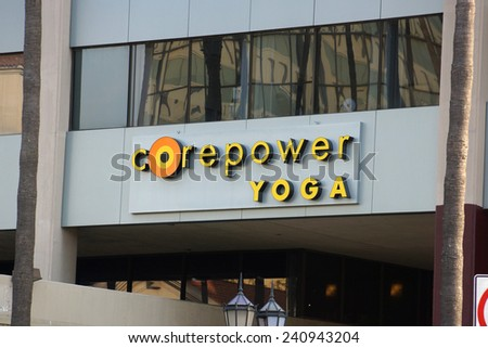 LOS ANGELES, USA - JANUARY 23, 2014: CorePower Yoga Studio Sign on Hollywood boulevard.  Founded in Denver, Colorado, in 2002, CorePower Yoga is a rapidly growing yoga chain. - stock photo