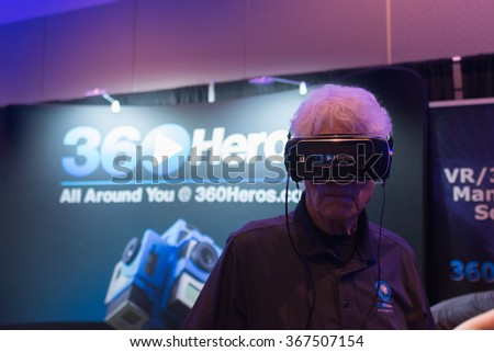 Los Angeles, USA - January 23, 2016: Man tries virtual reality headset during VRLA Expo Winter, virtual reality exposition, at the Los Angeles Convention Center. - stock photo