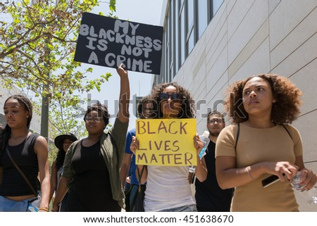 Los Angeles, USA - July 12, 2016 -  Black lives matter protestors holding a poster during march on City Hall following ruling on LAPD fatal shooting of African American female Redel Jones