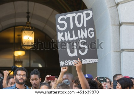 Los Angeles, USA - July 12, 2016 -  Black lives matter protestors holding a poster during march on City Hall following ruling on LAPD fatal shooting of African American female Redel Jones - stock photo