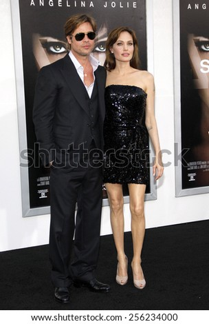 """LOS ANGELES, USA - JULY 19: Brad Pitt and Angelina Jolie at the Los Angeles Premiere of """"Salt"""" held at the Grauman's Chinese Theater in Hollywood, USA on July 19, 2010. - stock photo"""